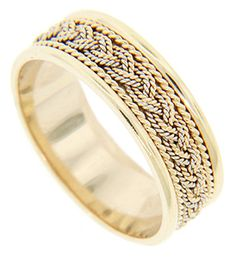 Spiraling yellow gold patterns are on either side of the braid in the center. Polished edges complete the whole. The wedding ring measures 6.6mm in width. Size: 8 1/2. Double spirals are separated by smooth bands on this 14K yellow gold antique style men's wedding ring. The wedding band measures 6.2mm in width. Size: 4. Cannot be re-sized, but we can reorder the ring in any size and in white gold, yellow gold, platinum palladium or any combination of metals.