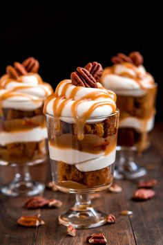 Dig in to one of these heavenly Mini Caramel Pecan Pumpkin Cheesecake Trifles layered with rich brown sugar caramel, toasted pecans, cheesecake filling, and moist pumpkin cake. Mini Trifle, Trifle Cake, Cheesecake Trifle, Trifle Recipe, Raspberry Cheesecake, Mini Cheesecakes, Pumpkin Trifle, Pumpkin Dessert, Pumpkin Cheesecake