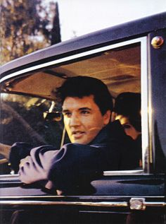 Elvis and Priscilla stopping to say hello to fans outside Graceland.