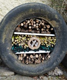 How to make a recycled tyre bug hotel (post sponsored by Volkswagen) · vicky myers creationsCreate your own recycled tyre bug hotel. Learn how to make an easy bug hotel with an old tyre, and ,materials from aound your garden. Step by step tutorial. Tire Garden, Garden Bugs, Garden Art, Mosaic Garden, Veg Garden, Bug Hotel, Permaculture, Forest School Activities, Sensory Garden