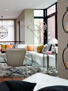 modern living room.. shag rugs are back!  I do like the overall light (white) color with a bit of black and pops of yellows... the yellows warm up the look.