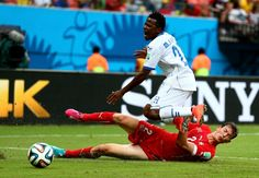 Marvin Chavez of Honduras is tackled by Stephan Lichtsteiner of...