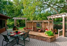 Want to add interest to your outdoor living space? Try combining Stone and wood for your next outdoor project, the results may surprise you! #hunkeconstruction #deck #patio #outdoor #dreamspace #summerfun