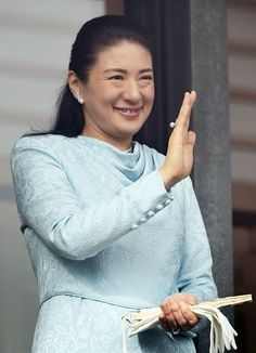 Japan's Crown Princess Masako waves to well-wishers during the imperial family's new year greeting 2015 in Tokyo