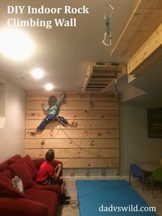 DIY wood panel indoor rock climbing wall. About 3 hours and $70 for some 2 by 4s and 1 by 10 pine boards