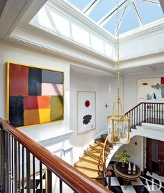 As part of their update, John B. Murray Architect and interior design firm Cullman & Kravis strikingly transformed the entrance hall, where an expanded skylight now illuminates paintings by (from left) Sean Scully, Adolph Gottlieb, and Giorgio Cavallon | archdigest.com