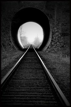 The location of this interesting photo of tracks entering a tunnel is a mystery, as well as the photographer.