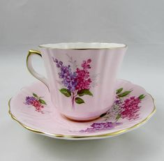 Old Royal tea cup and saucer, with beautiful hydrangea flowers. Tea cup and saucer are pink. Tea cup and saucer have gold trimming. In excellent condition (see photos). Markings read: Est 1846 Old Royal Bone China England Please bear in mind that these are vintage items and there