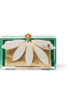 Decorated with white petals surrounding a nectar-yellow crystal at the top, Charlotte Olympia's Perspex 'Pandora' clutch is a nostalgic ode to summer days spent asking daisies if 'he loves me, he loves me not'. Embellished with an enameled brass ladybug, this Italian-made accessory comes with a glittering gold pouch to secure your essentials. x
