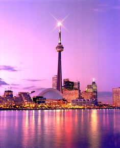 A lavender and pale pink sky shinning over Toronto and the iconic CN Tower.