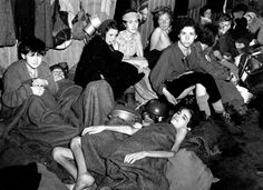 Women and children, some of over 40,000 concentration camp inmates liberated by the British, suffering from typhus, starvation and dysentery, huddle together in a barrack at Bergen-Belsen, Germany, in April 1945. (AP Photo)