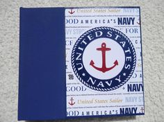 This 6x6 inch chipboard scrapbook album has a US Navy theme. This photo album can help you remember those special memories while your sailor is away from home. This album has 14 pages and mats for 15 pictures. There are also several sturdy machine sewn pockets inside where you can add even more pictures or memorabilia. The spine of this album is navy blue and the papers used inside have navy phrases and emblems. Patterned papers have shades of blues, reds, and golds. Each page has a unique…