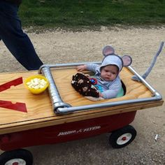 "Perfect costume so that little toddler can join in on the ""Treating"" - Also helps mom & dad's back, no carrying children while walking door to door - Toddler / Baby Halloween Costume - Mouse stuck in Trap - DIY wagon with mouse trap"