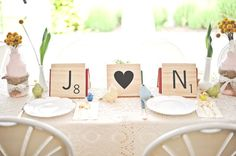 LOVE this!  Such a cute accent whether you're incorporating scrabble tiles in your wedding or not.