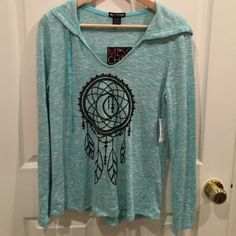 Cute and Light Teal Hooded Sweater Brand New!  Very cute teal hooded sweater with dream catcher design on the front. Slight high-low design. 56% rayon 42% polyester 2% spandex.  Purchased at Macy's. Shoulder to hem is approximately 25 inches. Miss Chievous Tops Sweatshirts & Hoodies