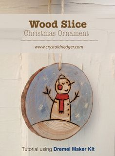 DIY Wood Slice Christmas Ornament Tutorial by Crystal Driedger. Includes free printable template for 2 different snowman poses.