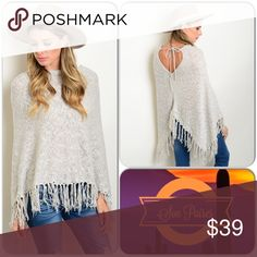 Light Gray Poncho Super cute poncho features back tie and fringe ends. One Size Fits all. Excellent piece to add to your winter wardrobe. 100% Acrylic. (This closet does not trade or use PayPal) Boutique Sweaters Shrugs & Ponchos
