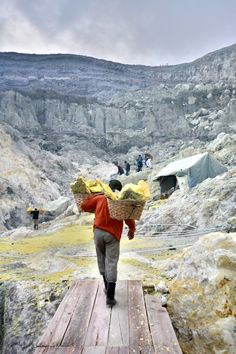 """Man collecting sulfur at the  Kawah Ijen,  Indonesia's """"Blue Fire"""" Volcano."""