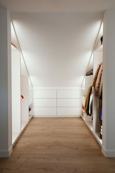 Walk-in closet under a sloping roof with indirect LED lighting. Walk-in closet under a sloping roof with indirect LED lighting. The post Walk-in closet under a sloping roof with indirect LED lighting. appeared first on Kleiderschrank ideen. Loft Room, Closet Bedroom, Attic Rooms, Attic Spaces, Attic Bedroom Designs, Attic Storage, Bedroom Storage, Storage Units, Storage Solutions