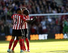 England defender Nathanial Clyne (L) rushes to congratulate Mane in the sunshine on the so...