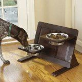 An adjustable raised dog feeder that grows with your dog. Cleverly designed, this solid wood feeder allows you to separately adjust the height of either bowl.