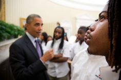 "2013: A Year in Photos June 5, 2013  ""A student eyes the Emancipation Proclamation as the President gave students from William R. Harper High School in Chicago a tour of the Oval Office."" (Official White House Photo by Pete Souza)"