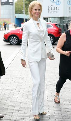 The Australian actress is white hot while heading to an event in London.