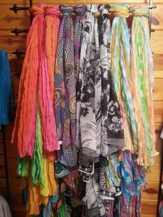 A super easy scarf display for your store or at home to organize your own scarves.