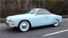 1968 Volkswagen Karmann Ghia in light blue. Very few cars can pull this color off.