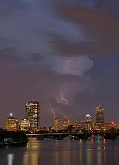 Boston skyline photography at twilight showing famous landmarks such as John Hancock building, Prudential Center and Longfellow Bridge while severe thunder and lightning move through the city and picture.  Good light and happy photo making!  My best,  Juergen www.RothGalleries.com www.ExploringTheLight.com http://whereintheworldisjuergen.blogspot.com https://www.facebook.com/naturefineart @NatureFineArt