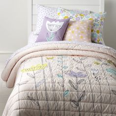 Shop Pastel Floral Bedding. Adorned with soft, stylish flowers, this floral bedding set will instantly freshen up any kids room. The appliqued quilt reverses to solid pink, making it like two quilts in one. And the duvet cover features a printed floral design.