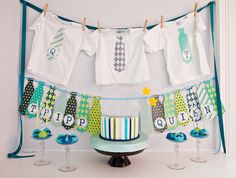 love the ties out of scrapbook paper. It's a little man shower! Perfect for a baby boy shower