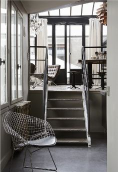 Artichoke Chandelier, Bertoia Chair, Framed Windows and a Crystal Chandelier - how awesome is this??