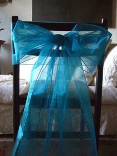 Cover chairs without using chair covers? | Weddings, Do It Yourself | Wedding Forums | WeddingWire Simple tulle bow on each chair at table
