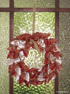the red thread paper wreath door - site has several excellent tutorials' example uses wrapping paper, but could likely be made with scrapbook paper or digi supplies...
