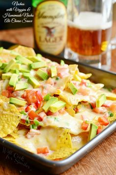 Amazing Nachos with Veggies and Homemade Nacho Ale Cheese Sauce. Easy and amazing snack to serve at your next football party! from willcookforsmiles.com