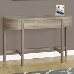 Features:  -1 Storage drawer.  -Spacious surface to showcase your favorite items.  -Can be used as a make up vanity table.  Top Finish: -Dark taupe.  Base Finish: -Dark taupe.  Top Material: -Manufact