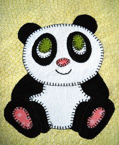 Giant panda PDF applique baby quilt block pattern  This baby panda would like to cuddle! You could use this 7 by 7 square block as part of a whimsical giant panda baby quilt, wall decoration, mug rug, pillow, busy book for a toddler or a cute tote bag. Just use your imagination!  The 3-page printable childs quilt pattern includes ready-to-use individual pieces and a full-sized applique layout guide, along with instructions for creating your own adorable baby panda. Just print and youre ready…