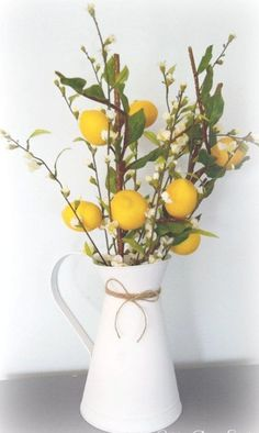 Farmhouse Lemon Branch and Cherry Blossom Arrangement in White Pitcher Capturing the charming beauty of farmhouse decor, this gorgeous lemon branch and cherry blossom arrangement will bring a. Country Farmhouse Decor, Farmhouse Kitchen Decor, Country Chic, Country Kitchen, French Country, Farmhouse Style, Lemon Centerpieces, Lemon Kitchen Decor, Yellow Accents