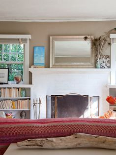 Love the half Windows on either side of fireplace