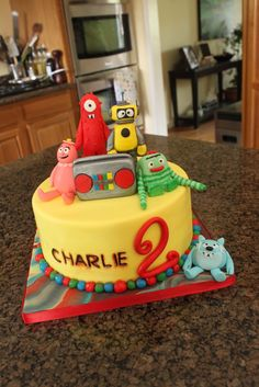 Yo Gabba Gabba @Tiffany Storbeck Hobson round cake with yellow frosting - can you then buy the little Gabba dudes at walmart or something?