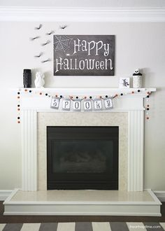 Halloween mantel that is simple, clean lines and really cute.