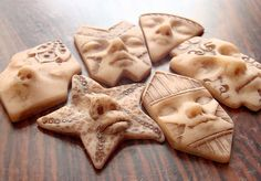 Polymer clay faces, unpainted by graphixoutpost, via Flickr