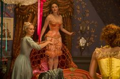 Cinderella 2015 costumes. Ella, Lily James; Anastasya, Holliday Grainger; Griselda, Sophie McShera undergarments. pink satin corset and chemise, pink cage and bloomers/pantaloons/drawers. Yellow corset (back) and chemise. servant costume Victorian. fantasy