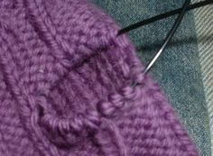 The Thumb Trick,  for mittens  The trick: Knit to where you want to place the thumb hole, and take a length of contrasting yarn, and knit the thumbhole stitches with it instead of your working yarn: