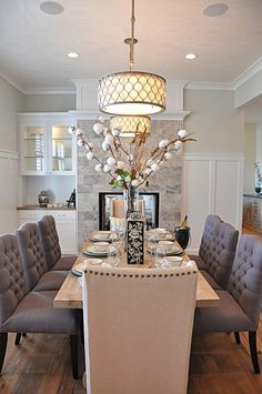 Elegant dining room. Love to the double drum pendant lighting.