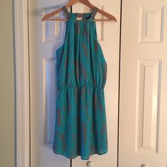 Aqua from Nordstroms sleeveless dress keyhole back Aqua with deep coral print dress. Sleevless with keyhole in back fitted around neck . Beautiful dress perfect for any night out. Aqua Dresses Mini