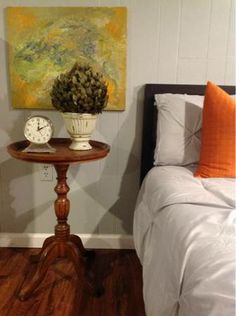 Painting behind bedside table