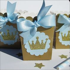 Our hand made baby blue and gold glitter crown popcorn favor boxes are perfect for a baby shower or his first birthday party. Add sparkle to your dessert table