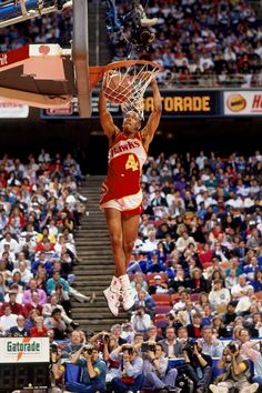 "On February 8, 1986, Spud Webb, who at 5'7"" was one of the shortest players in the history of professional basketball, wins the NBA slam dunk contest, beating his Atlanta Hawks teammate and 1985 dunk champ, the 6'8"" Dominique Wilkins."